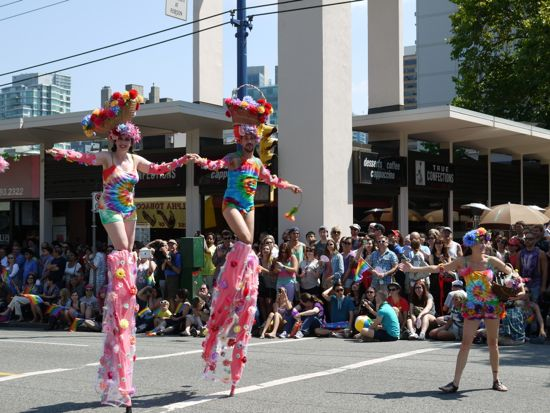 Naomi Singer and Lindsey Shepek stilt walking in Pride Parade